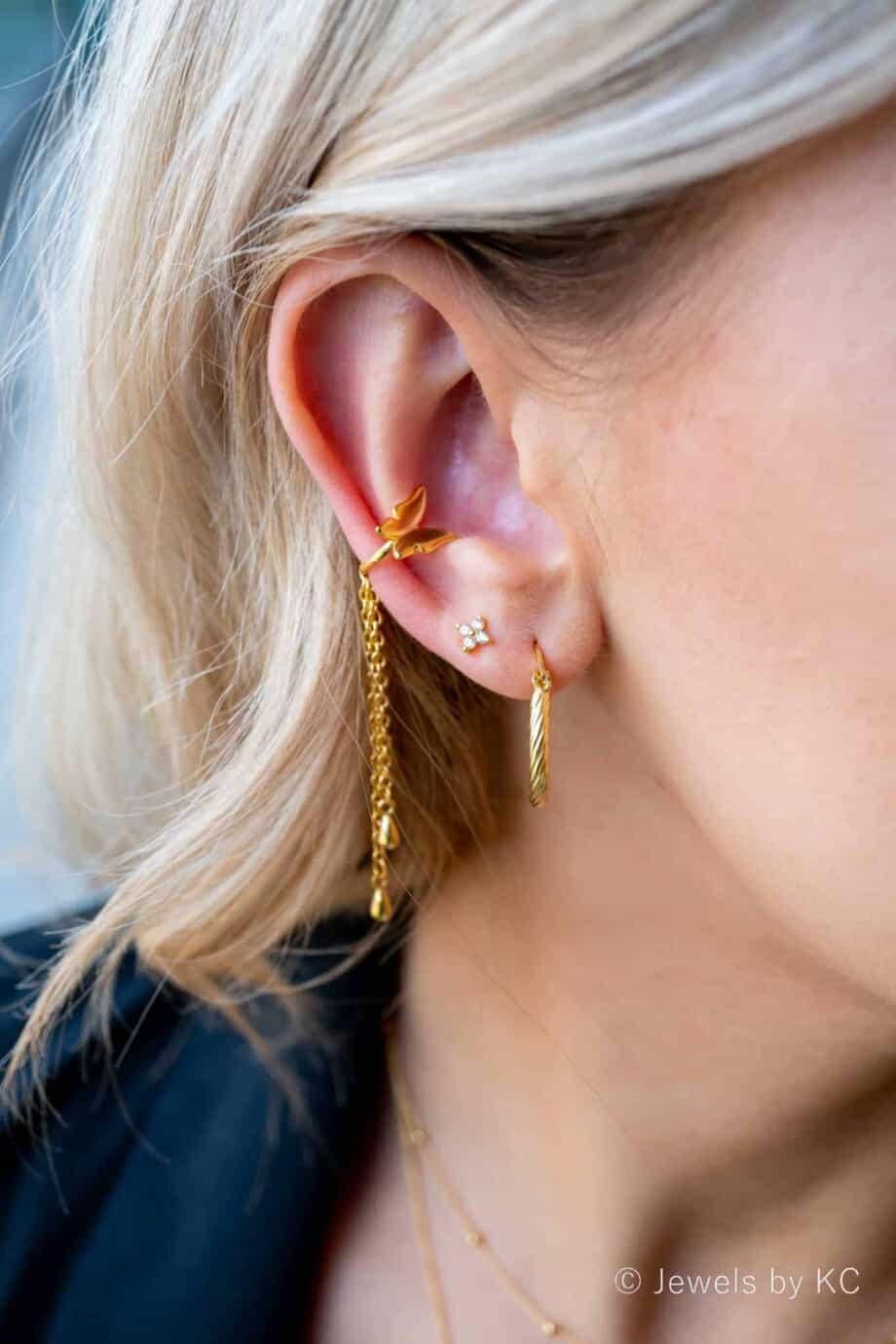 Gouden ear cuff 'Vlinder' van Goud op Zilver