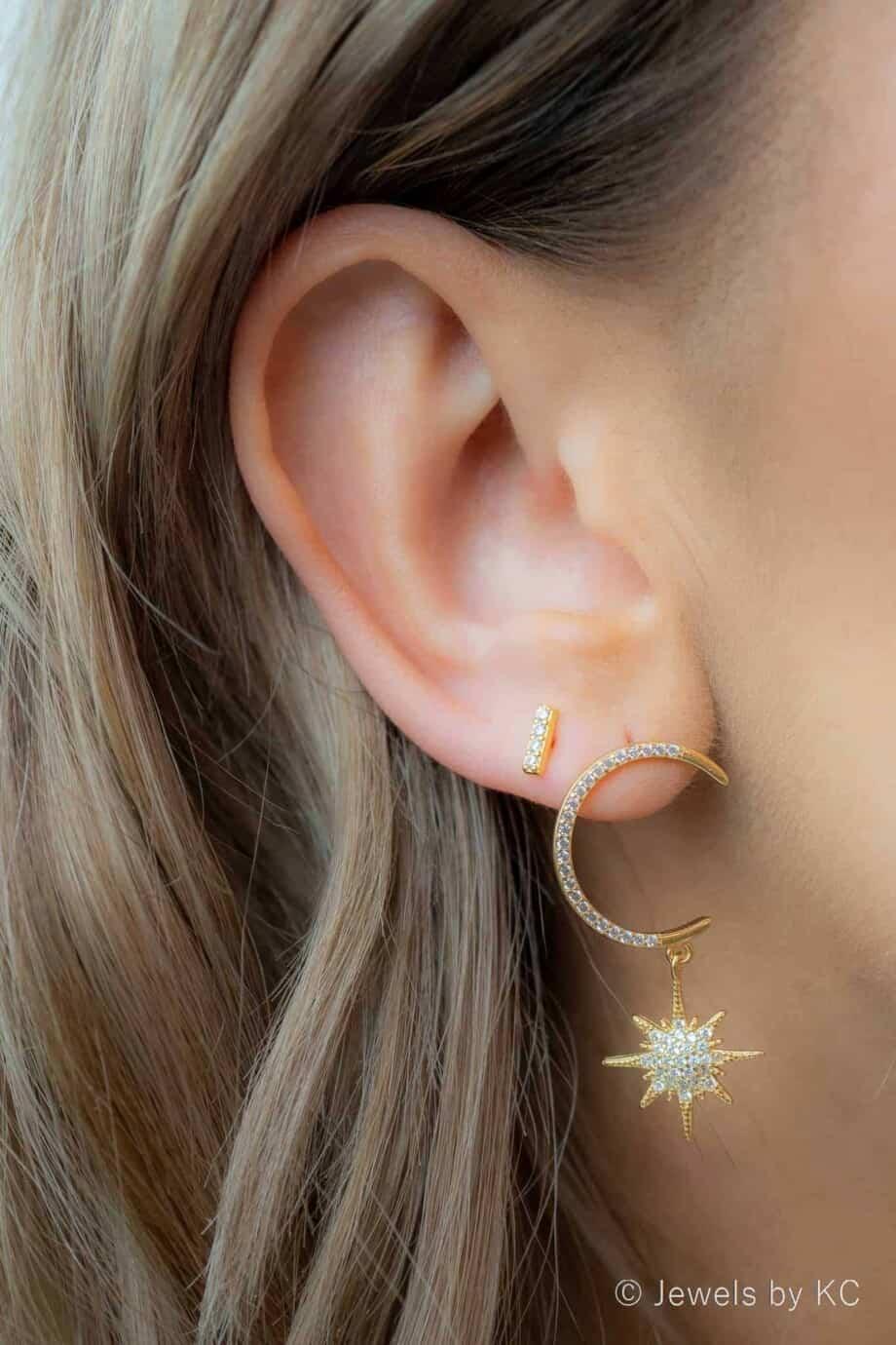 Gouden oorbellen 'Dangling star' van Goud op Zilver