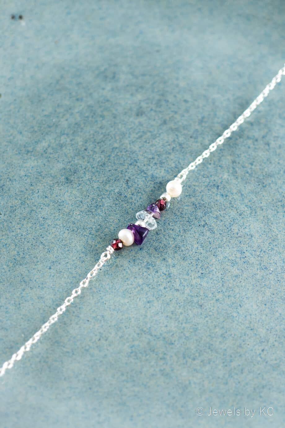 Zilveren edelsteen armbandje met rode Granaat en paarse Amethist