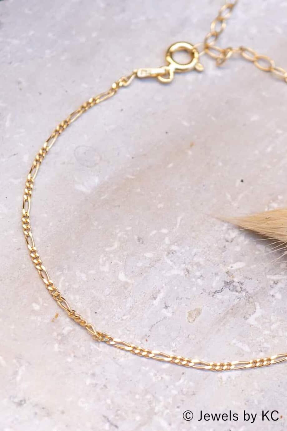 Gouden-armband-Golden-Figaro-van-Goud-op-Zilver