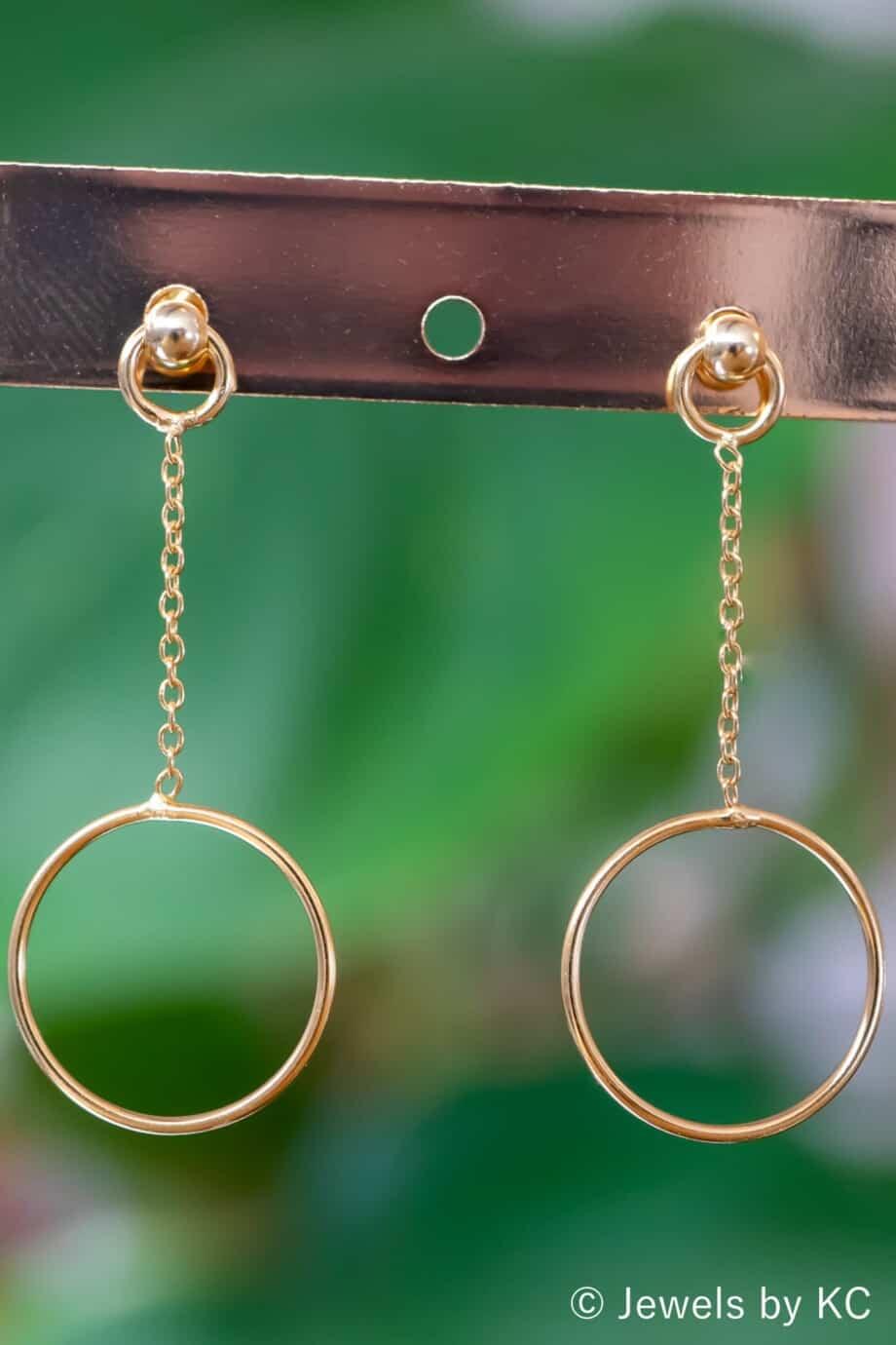 Gouden oorbellen 'Swinging circle' Goldplated zilver